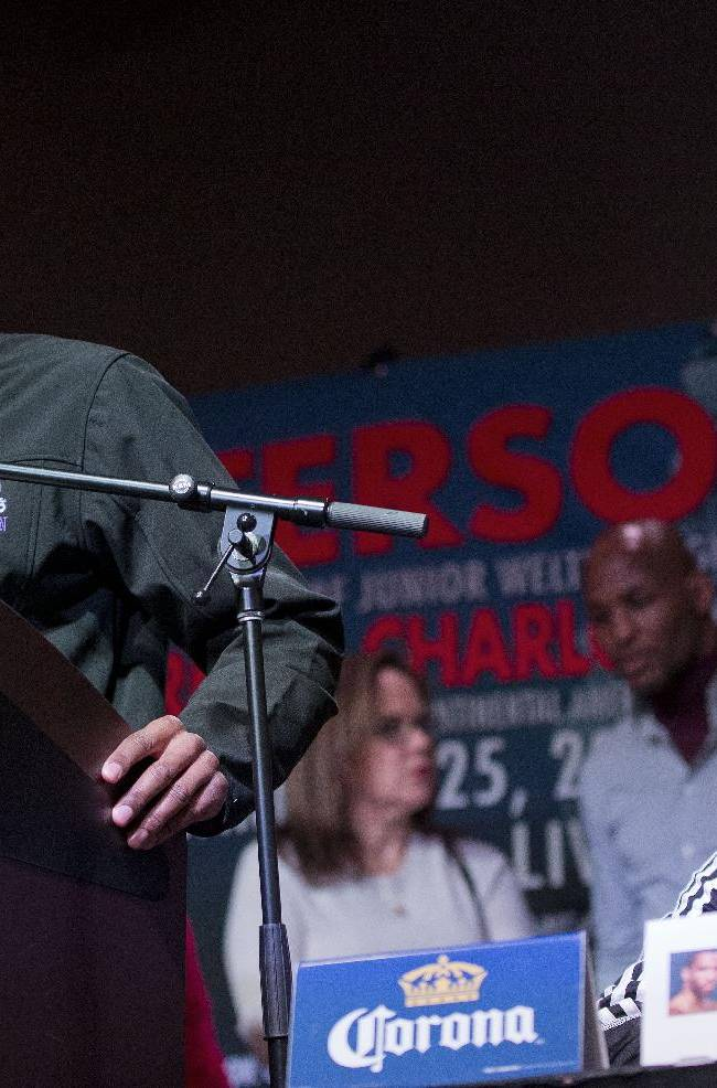 IBF junior welterweight champion Lamont Peterson speaks during a boxing news conference, Thursday, Jan. 23, 2014 in Washington. Peterson is slated to defend his title against Canadian challenger Dierry Jean, right, on Saturday at the DC Armory