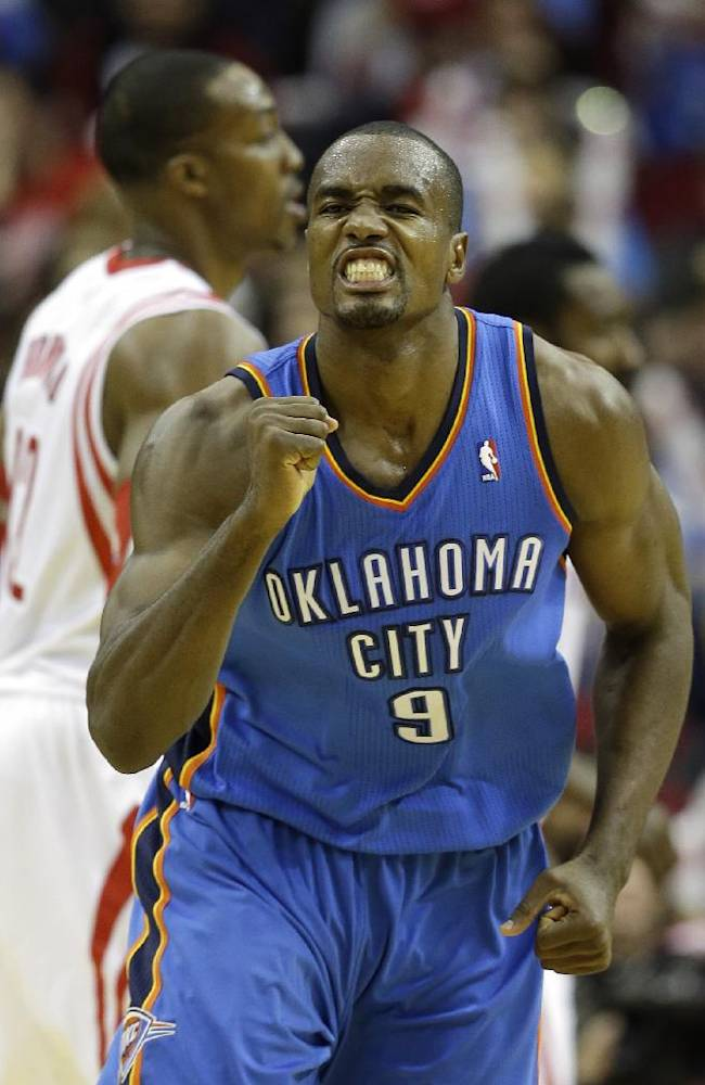 Oklahoma City Thunder's Serge Ibaka (9) pumps his fist after sinking a basket during the fourth quarter of an NBA basketball game against the Houston Rockets Thursday, Jan. 16, 2014, in Houston. The Thunder beat the Rockets 104-92