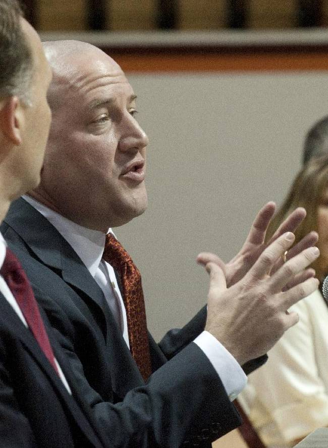 Marquette's former men's head basketball coach and now Virginia Tech's new men's head basketball coach, Buzz Williams, at an introductory press conference with his wife Cory in background and Tech A.D. Whit Babcock (left) held at Cassell Coliseum, in Blacksburg, Virginia, Monday, March 24, 2014
