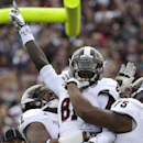 Mississippi State wide receiver De'Runnya Wilson (81) celebrates with teammates after catching a touchdown pass against Texas A&M during the second quarter of an NCAA college football game Saturday, Nov. 9, 2013, in College Station, Texas The Associated P