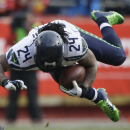Seattle Seahawks running back Marshawn Lynch (24) stumbles in the first half of an NFL football game against the Kansas City Chiefs in Kansas City, Mo., Sunday, Nov. 16, 2014 The Associated Press