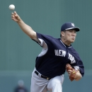 New York Yankees starting pitcher Masahiro Tanaka pitches in the first inning of an exhibition baseball game against the Minnesota Twins in Fort Myers, Fla., Saturday, March 22, 2014 The Associated Press