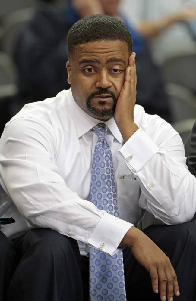 In this March 12, 2009, file photo, Miami coach Frank Haith reacts on the bench during the second half against Virginia Tech in an NCAA college basketball game at the Atlantic Coast Conference men's tournament in Atlanta. Missouri men's basketball coach Haith faces a 5-game suspension after the NCAA found he failed to monitor his former assistants' interactions with a disgraced Miami booster. The NCAA released the findings of its investigation into convicted felon Nevin Shapiro's relationship with Miami athletics on Tuesday, Oct. 22, 2013. It found that then-Miami coach Haith and an assistant coach provided Shapiro $10,000 after he threatened to expose previous improper contact with high school recruits and amateur coaches