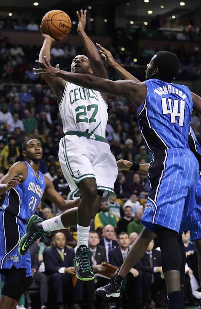 Boston Celtics guard Jordan Crawford (27) drives to the basket against Orlando Magic forward Andrew Nicholson (44) during the first quarter of an NBA basketball game, in Boston, Monday, Nov. 11, 2013