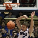 Duke's Mason Plumlee (5) dunks against Ohio State during the second half of an NCAA college basketball game in Durham, N.C., Wednesday, Nov. 28, 2012. Duke won 73-68. (AP Photo/Gerry Broome)