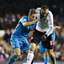Fulham's Dimitar Berbatov, right, fights for the ball with Tottenham Hotspur's Michael Dawson during their English Premier League soccer match, at the Craven Cottage stadium in London, Wednesday, Dec. 4, 2013