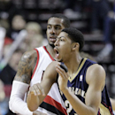 New Orleans Pelicans forward Anthony Davis, right, calls to teammates as Portland Trail Blazers forward LaMarcus Aldridge defends during the second half of an NBA basketball game in Portland, Ore., Sunday, April 6, 2014. Davis scored 15 points and Aldridge had 25 as the Trail Blazers won 100-94. (AP Photo/Don Ryan)
