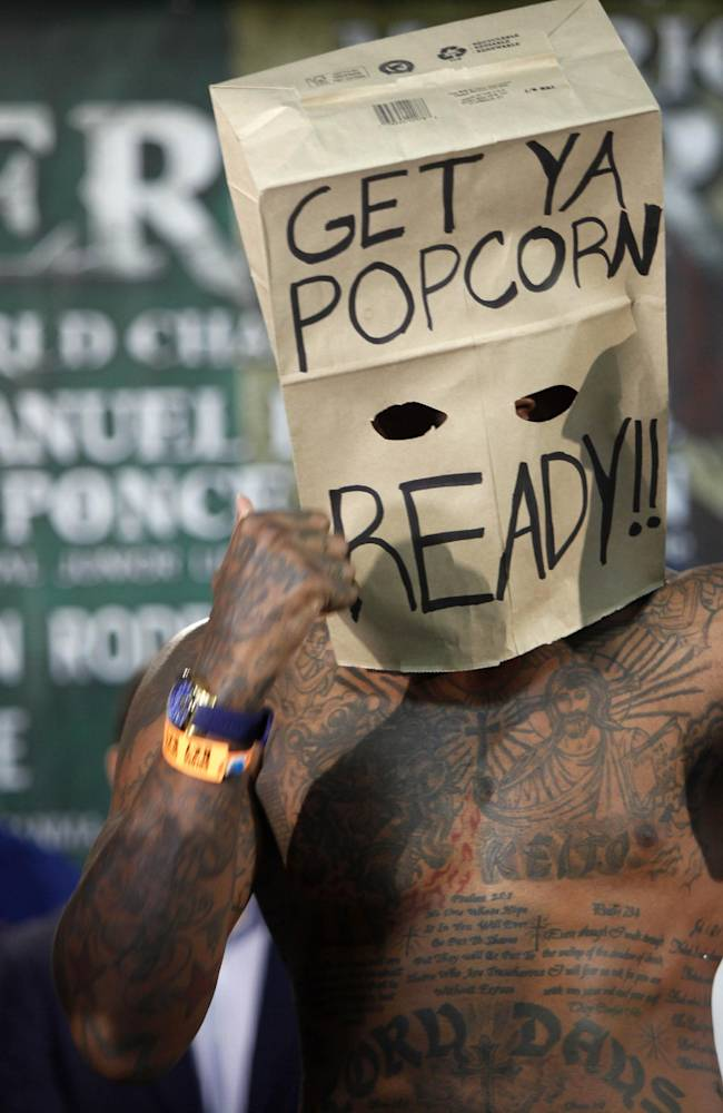 WBC Continental Americas Heavyweight Champion Deontay Wilder, left, and contender Malik Scott, wearing a mask made from a paper bag, pose for photos after the official weigh-in at the Ruben Rodriguez Coliseum in Bayamon, Puerto Rico, Friday, March 14, 2014. Wilder will defend his title against Scott in a Showtime Championship Boxing co-main event Saturday