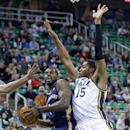 New Orleans Pelicans' Tyreke Evans, left, goes to the basket as Utah Jazz's Derrick Favors (15) defends in the first quarter during an NBA basketball game on Friday, April 4, 2014, in Salt Lake City The Associated Press