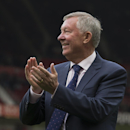 In this Sunday, Oct. 5, 2014, Manchester United former manager Alex Ferguson applauds supporters before the team's English Premier League soccer match against Everton at Old Trafford Stadium, Manchester, England. Ninety minutes after the return of