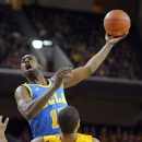 UCLA forward Shabazz Muhammad, top, shoots as Southern California guard Jio Fontan (1) falls during the first half of their NCAA college basketball game, Sunday, Feb. 24, 2013, in Los Angeles. (AP Photo/Mark J. Terrill)