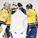 Nashville Predators goalie Pekka Rinne (35), of Finland, celebrates with center Mike Ribeiro (63) after they beat the Edmonton Oilers 3-2 in an NHL hockey game Tuesday, Nov. 11, 2014, in Nashville, Tenn The Associated Press