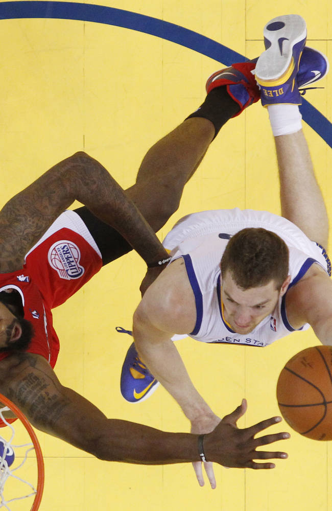 Golden State Warriors' David Lee, right, shoots next to Los Angeles Clippers' DeAndre Jordan during the second half in Game 6 of an opening-round NBA basketball playoff series on Thursday, May 1, 2014, in Oakland, Calif. Golden State won 100-99
