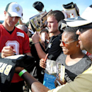 New Orleans Saints quarterback Drew Brees signs autographs for fans during NFL football training camp in White Sulphur Springs, W.Va., Saturday, July 26, 2014 The Associated Press