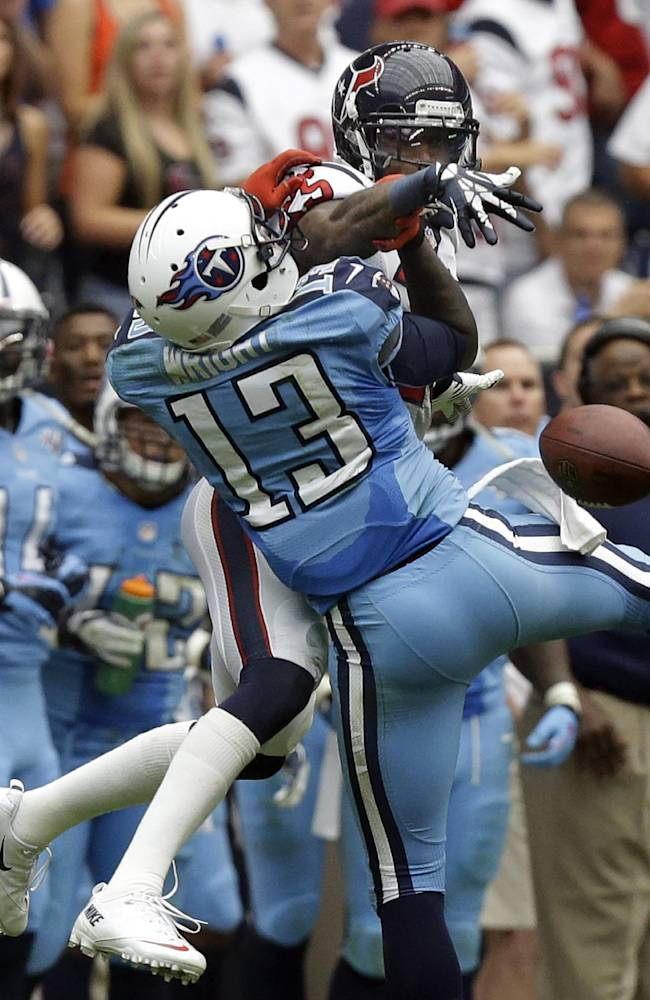 Houston Texans' Kareem Jackson, right, breaks up a pass intended for Tennessee Titans' Kendall Wright (13) during the third quarter of an NFL football game on Sunday, Sept. 15, 2013, in Houston