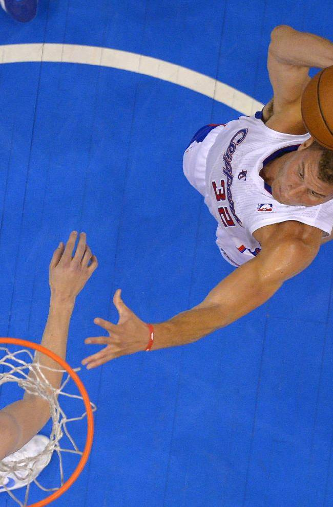 Los Angeles Clippers forward Blake Griffin, right, goes up for a dunk as Denver Nuggets forward Jan Vesely, of the Czech Republic, defends during the first half of an NBA basketball game, Tuesday, April 15, 2014, in Los Angeles