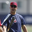 Cleveland Indians' Nick Swisher does a little bat tapping around the batting cage prior to a spring training exhibition baseball game against the San Diego Padres Saturday, March 29, 2014, in San Diego The Associated Press