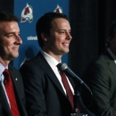 Josh Kroenke, center, smiles while speaking during a news conference at which he was introduces as the new president of the C