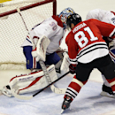 Chicago Blackhawks' Marian Hossa (81) scores against Montreal Canadiens goalie Peter Budaj (30) during the third period of an NHL hockey game in Chicago, Wednesday, April 9, 2014. The Blackhawks won 3-2 in overtime The Associated Press