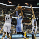 Denver Nuggets guard Randy Foye (4) drives against Memphis Grizzlies forwards Zach Randolph (50) and Tayshaun Prince in the first half of an NBA basketball game Friday, April 4, 2014, in Memphis, Tenn The Associated Press