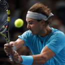 Rafael Nadal of Spain backhands the ball to Jerzy Janowicz of Poland during their round of eight match, at the Paris Masters tennis at Bercy Arena in Paris, France, Thursday, Oct. 31, 2013. (AP Photo/Francois Mori)