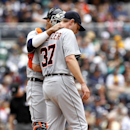 Detroit Tigers catcher goes out to the mound to confer with starting pitcher Max Scherzer during fourth inning play of a baseball game against the San Diego Padres Sunday, April 13, 2014, in San Diego The Associated Press