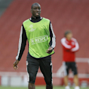 Besiktas' Demba Ba runs during a training session at Emirates Stadium in London Tuesday, Aug. 26, 2014. Arsenal will play Besiktas in a Champions League qualifying soccer match at the stadium on Wednesday