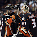 Anaheim Ducks' Ryan Kesler, from left, Patrick Maroon and goalie Frederik Andersen, of Denmark, celebrate their team's 2-1 win against the Edmonton Oilers in an NHL hockey game Wednesday, Dec. 10, 2014, in Anaheim, Calif The Associated Press