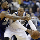 Dallas Mavericks forward Shawn Marion, right, keeps the ball from Phoenix Suns forward P.J. Tucker, left, during the first half of an NBA basketball game on Saturday, April 12, 2014, in Dallas The Associated Press