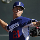 In this Monday, Feb. 10, 2014 file photo, Los Angeles Dodgers pitcher Zack Greinke throws during spring training baseball practice in Glendale, Ariz. Greinke and the Los Angeles Dodgers have knocked Rodriguez and the New York Yankees off baseball's payro