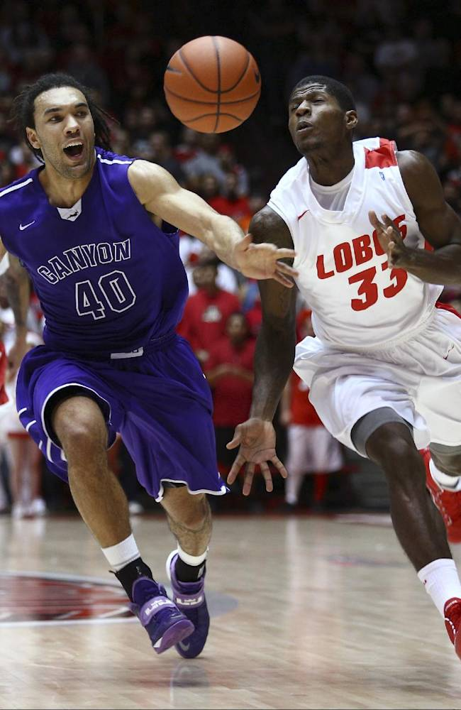 Grand Canyon's Blake Davis (40) races to to ball against New Mexico guard Deshawn Delaney (33) during the first half of an NCAA college basketball game in Albuquerque, N.M., Monday, Dec. 23, 2013