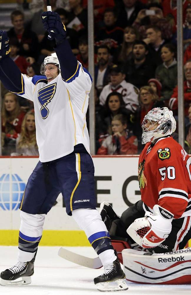 St. Louis Blues' David Backes (42) celebrates after scoring his goal as Chicago Blackhawks goalie Corey Crawford (50) reacts during the first period of an NHL hockey game in Chicago, Thursday, Oct. 17, 2013
