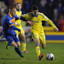 Shrewsbury's Ryan Woods, left, holds back Chelsea's Oscar, during the fourth round of the English League Cup soccer match between Shrewsbury Town and Chelsea, at Greenhous Meadow, Shrewsbury, England, Tuesday, Oct. 28, 2014