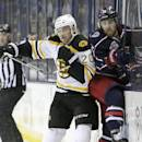 Boston Bruins' Daniel Paille, left, checks Columbus Blue Jackets' David Savard during the second period of an NHL hockey game Saturday, Dec. 27, 2014, in Columbus, Ohio. (AP Photo/Jay LaPrete)