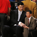 Houston Rockets' Yao Ming sits near the court during the NBA All Star basketball game, Sunday, Feb. 16, 2014, in New Orleans The Associated Press