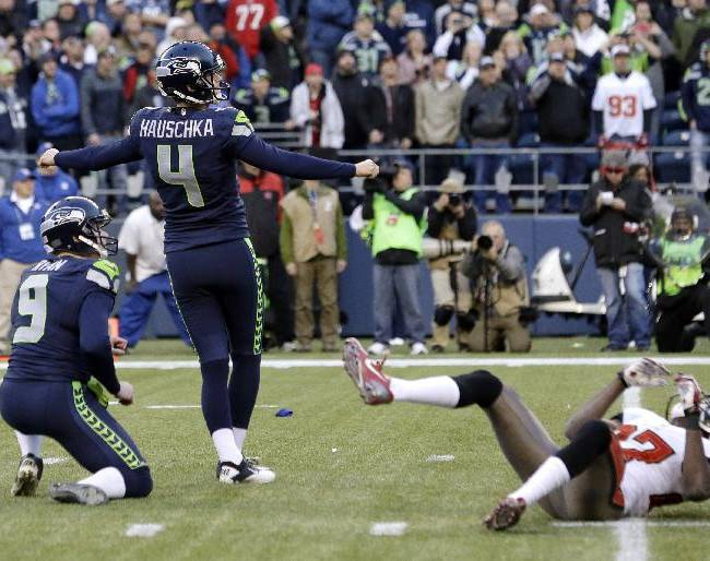 Seattle Seahawks' kicker Steven Hauschka (4) watches as his game-winning field goal is good in overtime as holder Jon Ryan watches the ball and Tampa Bay Buccaneers' Johnthan Banks, right, goes to the turf in an NFL football game Sunday, Nov. 3, 2013, in Seattle. The Seahawks won 27-24 in overtime