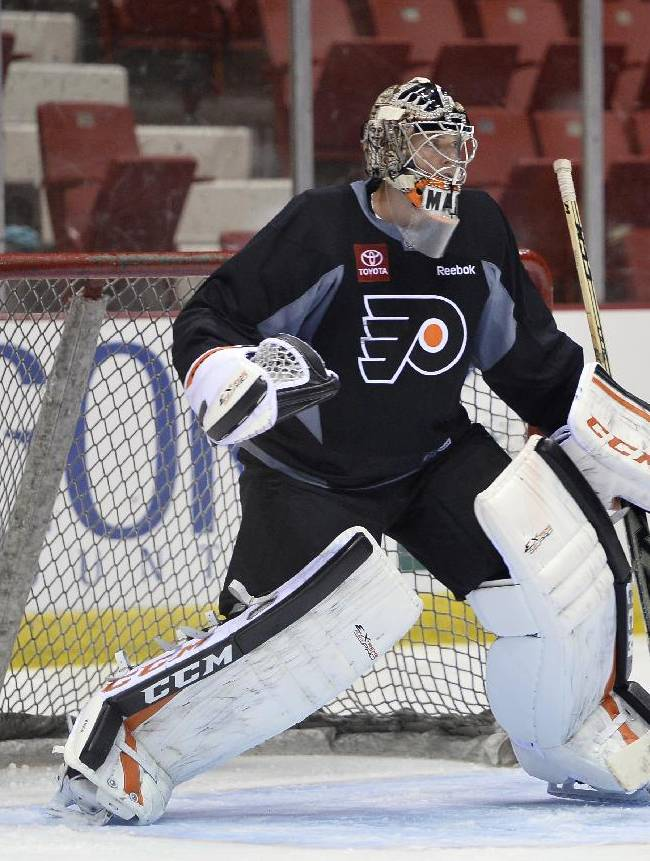 Philadelphia Flyers goalie Steve Mason waits for a shot during the NHL hockey team's training camp in Lake Placid, N.Y., on Thursday, Sept. 19, 2013