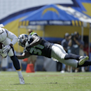 Seattle Seahawks strong safety Kam Chancellor, right, dives for San Diego Chargers wide receiver Keenan Allen during the first half of an NFL football game on Sunday, Sept. 14, 2014, in San Diego The Associated Press