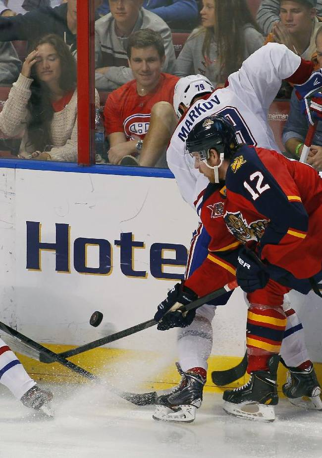 Montreal Canadiens center Daniel Briere (48) and Florida Panthers right wing Jimmy Hayes (12) battle for the puck during the third period of an NHL hockey game in Sunrise, Fla., Sunday, Dec. 9, 2013