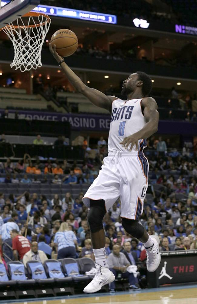 Charlotte Bobcats' Ben Gordon (8) drives to the basket against the Philadelphia 76ers during the first half of a preseason NBA basketball game in Charlotte, N.C., Thursday, Oct. 17, 2013. Gordon scored 22 points off the bench, and the Bobcats cruised to a 110-84 win