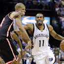 Memphis Grizzlies guard Mike Conley (11) drives against Miami Heat forward Shane Battier, left, in the second half of an NBA basketball game Wednesday, April 9, 2014, in Memphis, Tenn. The Grizzlies won 107-102 The Associated Press