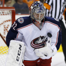 Columbus Blue Jackets' Sergei Bobrovsky, of Russia, blocks a shot during the second period of an NHL hockey game against the Philadelphia Flyers, Thursday, April 3, 2014, in Philadelphia The Associated Press