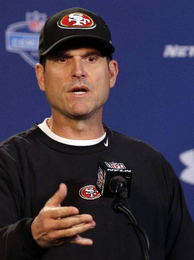San Francisco 49ers head coach Jim Harbaugh answers a question during a news conference at the NFL football scouting combine in Indianapolis, Thursday, Feb. 20, 2014
