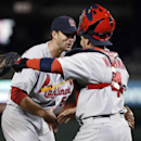 St. Louis Cardinals starting pitcher Adam Wainwright celebrates with catcher Yadier Molina after a baseball game against the Washington Nationals at Nationals Park on Thursday, April 17, 2014, in Washington. Wainwright threw a two-hitter as St. Louis won