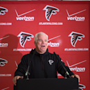 Atlanta Falcons head coach Mike Smith speaks during a press conference at The Grove Hotel in Watford England, Wednesday Oct. 22, 2014. The Falcons will play the Detroit Lions in an NFL football game at London's Wembley Stadium on Sunday, Oct. 26 The Assoc