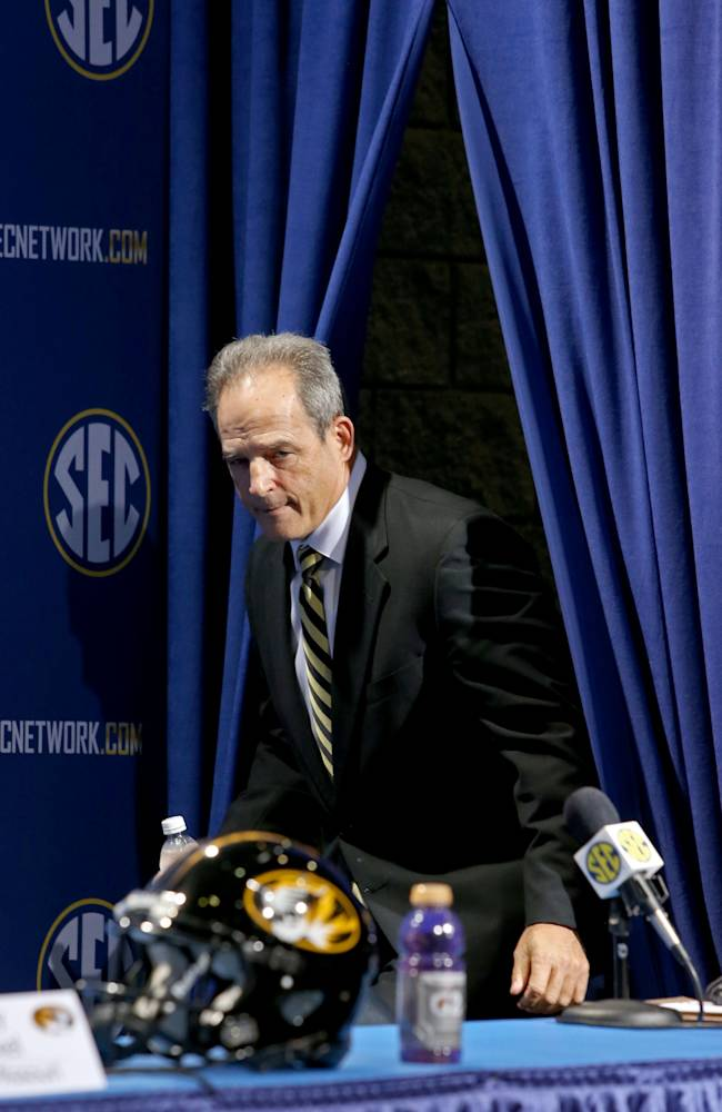 Missouri coach Gary Pinkel arrives for a press conference the day before the SEC football championship game against Auburn, at the Georgia Dome, Friday, Dec. 6, 2013,  in Atlanta, Ga.,