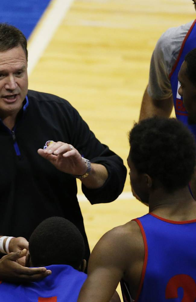 Kansas coach Bill Self talks with members of the Blue team during a NCAA college basketball scrimmage in Lawrence, Kan., Saturday, Oct. 19, 2013