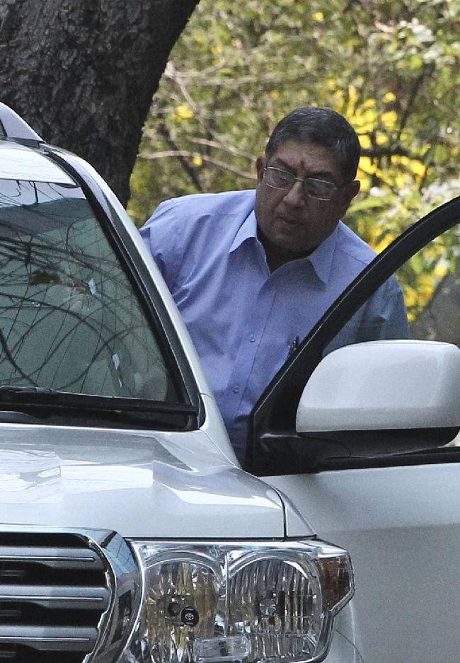 Indian cricket board chief Narayanaswami Srinivasan gets into his car at the premises of the corporate office of India Cements, a company headed by him in Chennai, India, Tuesday, March 25, 2014. The Supreme Court of India has told Srinivasan to step down from his post or be forced to leave to ensure a fair investigation into charges of match-fixing in the Indian Premier League
