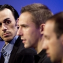 Vancouver Canucks goaltender Ryan Miller, left, listens as teammates speak to the media during the first day of NHL training camp, Thursday, Sept. 18, 2014 in Vancouver, British Columbia The Associated Press