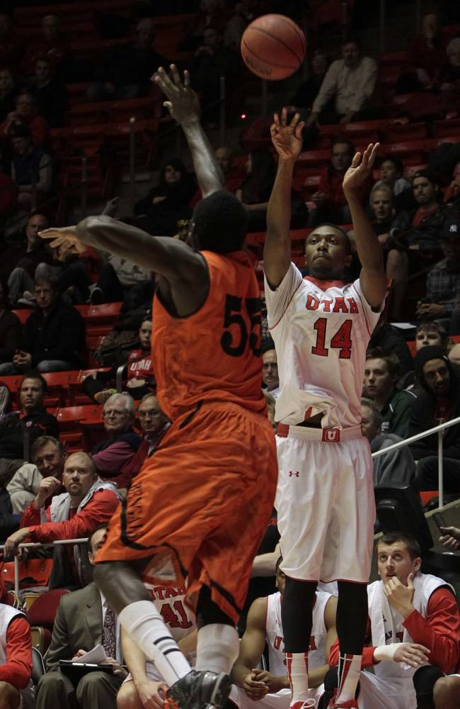 Utah Utes guard/forward Dakarai Tucker (14) fires off a sunken 3-pointer. University of Utah defeated Idaho State Bengals74-66,  Dec. 10, 2013 at the Huntsman Center